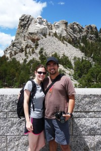 Grinning in front of Mt Rushmore